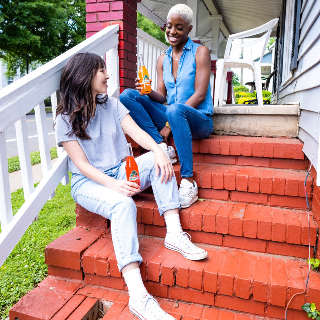 two friends chatting on a porch